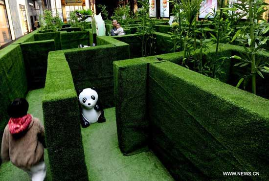 Parents and children explore a panda-themed labyrinth at a shopping mall in Shenyang, capital of northeast China
