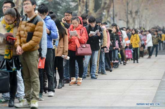 Candidates queue up to get into exam rooms at Hefei University of Technology exam site in Hefei, capital of east China