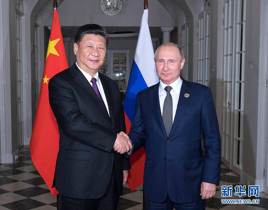 7月26日,国家主席习近平在南非约翰内斯堡同俄罗斯总统普京举行会晤并共进晚餐。