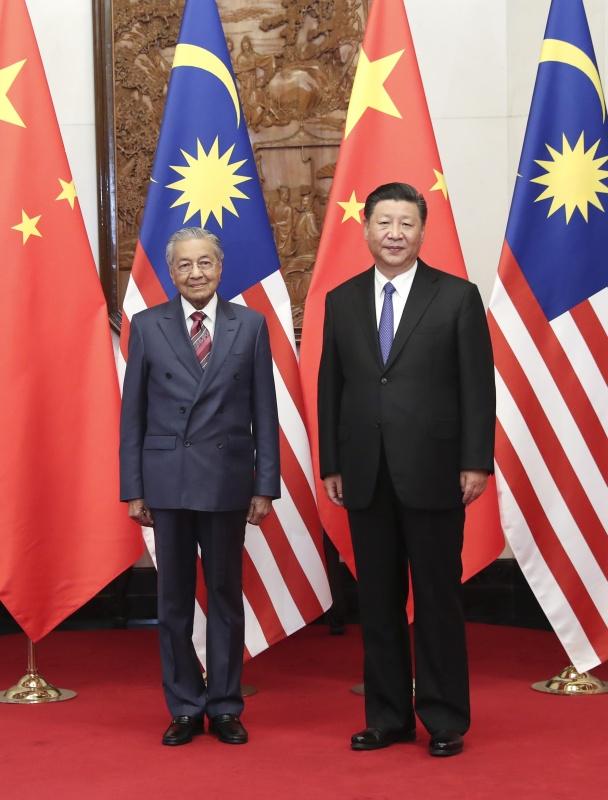 8月20日,国家主席习近平在北京钓鱼台国宾馆会见马来西亚总理马哈蒂尔。新华社记者 庞兴雷 摄