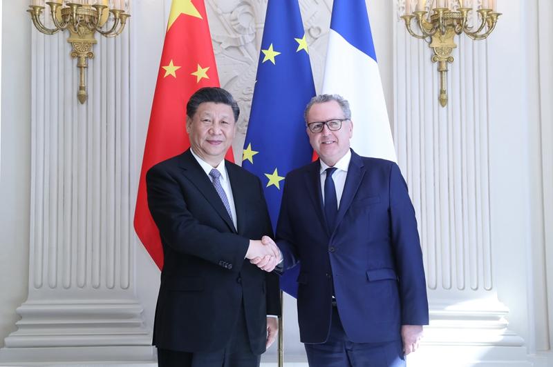 3月26日,国家主席习近平在巴黎会见法国国民议会议长费朗。