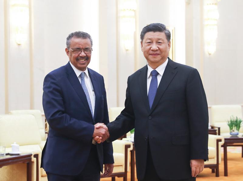 1月28日,国家主席习近平在北京人民大会堂会见世界卫生组织总干事谭德塞。
