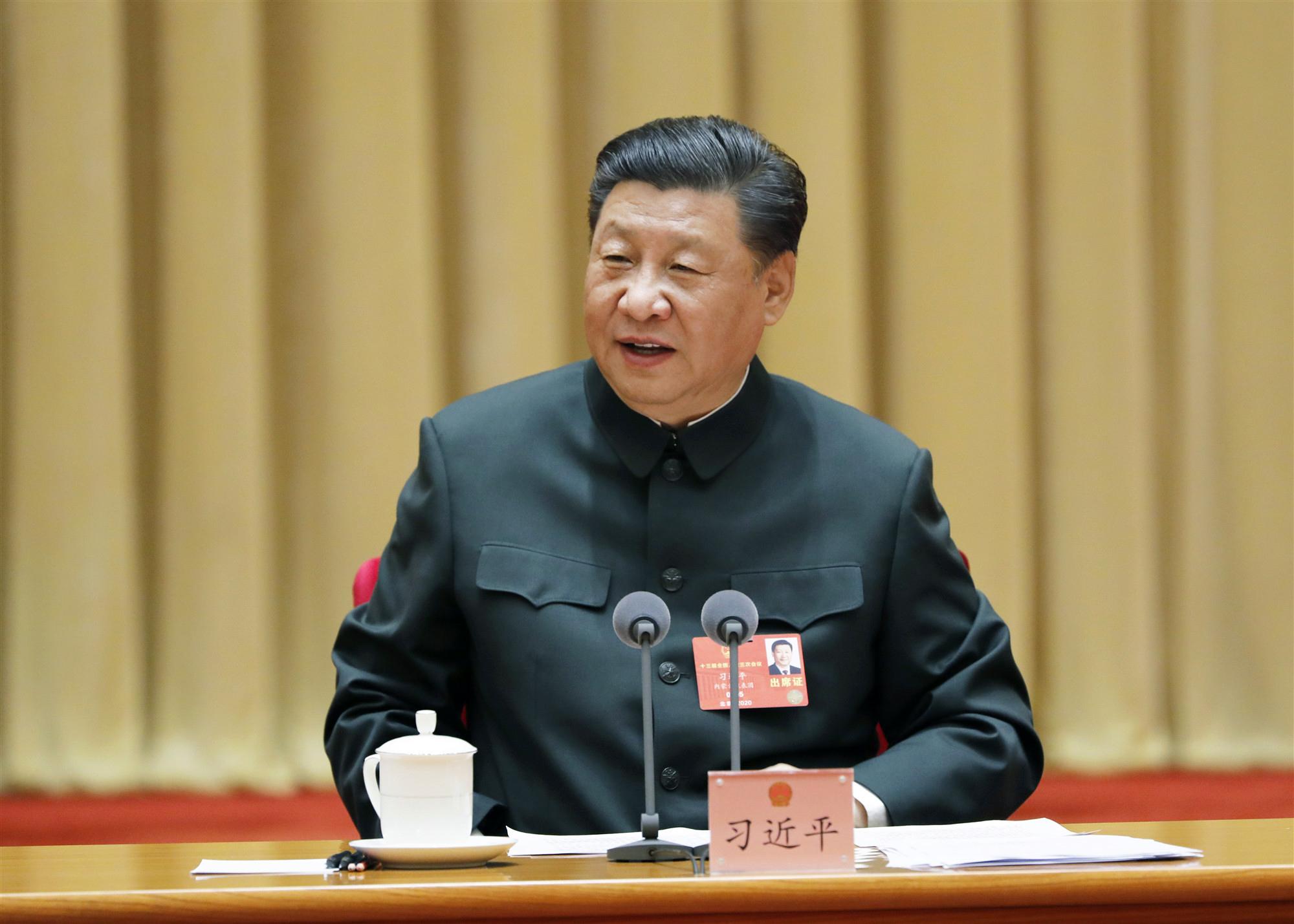 习近平在出席解放军和武警部队代表团全体会议时强调