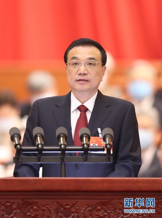 3月5日,李克强总理代表国务院在十三届全国人大四次会议上作《政府工作报告》。新华社记者 丁林 摄