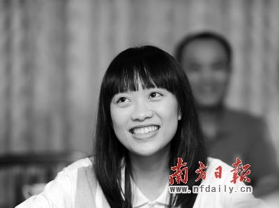 卢凯悦接受采访时露出自信的笑容.王辉