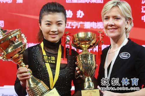 China's Fu Xiaofang edged British veteran Allison Fisher in the final to clinch her first world title.