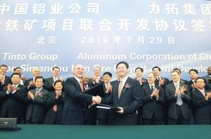 The Aluminum Corporation of China, or Chinalco, has formalized a joint venture with Rio Tinto to develop iron ore in Africa.
