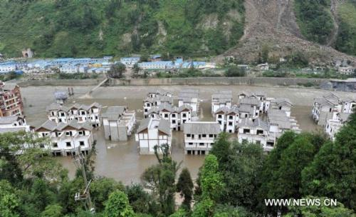 The water level of the Minjiang river, which savaged Yingxiu Township, gets lower in Wenchuan County, southwest China's Sichuan Province, Aug. 15, 2010. At least 31 people were missing after rain-triggered floods and landslides ravaged Wenchuan County early Saturday. Measures have been taken to carry on disaster relief work. (Xinhua/Chen Kai)