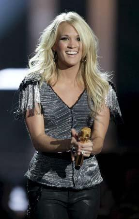 "AP Photo - Carrie Underwood accepts the ""Video of the Year"" award at the 2010 CMT Awards in Nashville, Tenn. Wednesday, June 9, 2010."