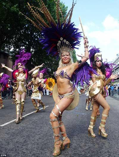 In costume: Revellers get into the swing of things at Notting Hill Carnival