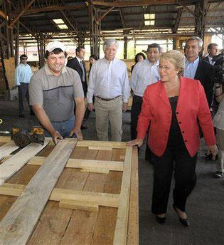 In this photo released by Chile's Presidency, President Michelle Bachelet visits a factory of emergency houses in Santiago, Wednesday, March 3, 2010. (AP Photo/Alex Ibanez, Chile's Presidency)