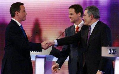Britain's opposition Conservative Party leader David Cameron (L), Liberal Democrat leader Nick Clegg and Prime Minister Gordon Brown (R) greet each other after the third and final televised party leaders' election campaign debate in Birmingham April 29, 2010.REUTERS/Gareth Fuller/Pool