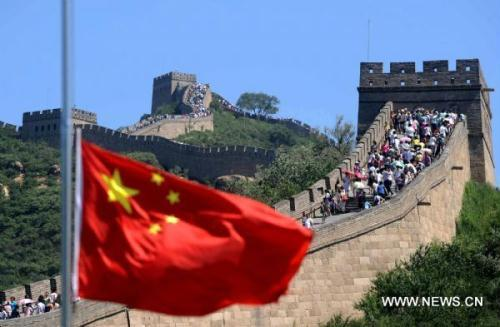 The national flag of China flies at half mast at the Badaling Great Wall in Beijing, capital of China, Aug. 15, 2010, to mourn for the victims of the Aug. 8 mudslide disaster in Zhouqu County, Gannan Tibetan Autonomous Prefecture in northwest China's Gansu Province. China on Sunday held mournings for the mudslide victims, all over the country and at overseas embassies and consulates. (Xinhua/Gong Lei)