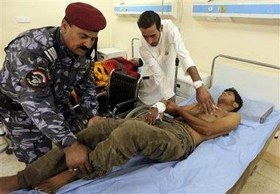 A wounded army recruit is transferred to a hospital after a bomb attack occurred in Baghdad August 17, 2010.REUTERS/Mohammed Ameen