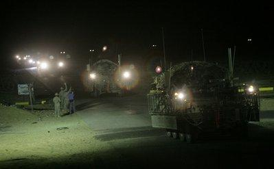 The last in a convoy of U.S. Army Stryker armored vehicles leave Iraq at the Khabari border crossing into Kuwait, Thursday, Aug. 19, 2010. The U.S. Army's4th Brigade, 2nd Infantry Division is the last combat brigade to leave Iraq as part of the drawdown of U.S. forces.(AP Photo/ Maya Alleruzzo)