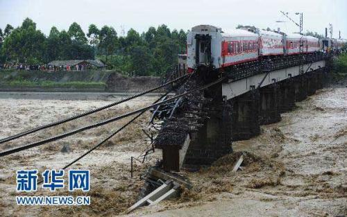 Two train cars plunged into a river in Southwest China's Sichuan Province earlier this week. 13-hundred passengers were transferred to safety, Luckily, no one was killed.