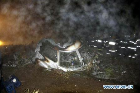 Rescuers search for bodies of victims beside the wreckage of a crashed passenger plane in Yichun City, northeast China's Heilongjiang Province, Aug. 25, 2010. The bodies of 43 passengers were recovered from the wreckage of the crashed passenger plane in northeast China's Heilongjiang Province late Tuesday, a local publicity official told Xinhua early Wednesday. (Xinhua/Li Guangfu)