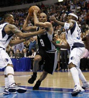 San Antonio Spurs guard Tony Parker (C) drives between Dallas Mavericks forward Caron Butler (L) and guard Jason Terry during the second half of Game 1 of their NBA Western Conference playoff series in Dallas, Texas April 18, 2010.« Read less REUTERS/Mike Stone (UNITED STATES - Tags: SPORT BASKETBALL)