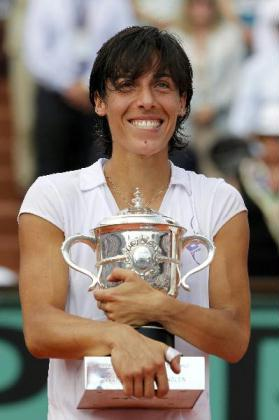 Francesca Schiavone of Italy poses with her trophy after winning the women's final against Samantha Stosur of Australia during their women's final at the French Open tennis tournament at Roland Garros in Paris June 5, 2010. (Xinhua/Reuters Photo)