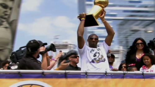 Downtown Los Angeles was a sea of purple and gold on Monday as thousands of fans lined the parade route on Figueroa Street for a chance to help celebrate the Lakers' NBA championship.