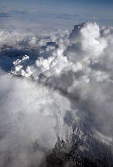 SmokebillowsfromaneruptingvolcanoontheEyjafjallajokullglacieronApril14.(AFP/IcelandicCoastGuard/File)