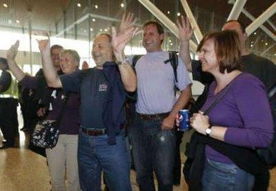Passengers of Malaysia Airline System's MH0001S gesture to journalists as they arrive from Frankfurt at Kuala Lumpur International Airport outside Kuala Lumpur April 21, 2010. The Malaysia airline's on Wednesday flew 338 stranded passengers from Frankfurt into the Kuala Lumpur's airport. The national carrier was the first carrier of ASEAN countries to operate flights out of Frankfurt. Europe's skies were opened for business on Wednesday, but with so many planes having been grounded by the pall of volcanic ash spreading from Iceland it could take days, or weeks, to clear the backlog.REUTERS/Bazuki Muhammad