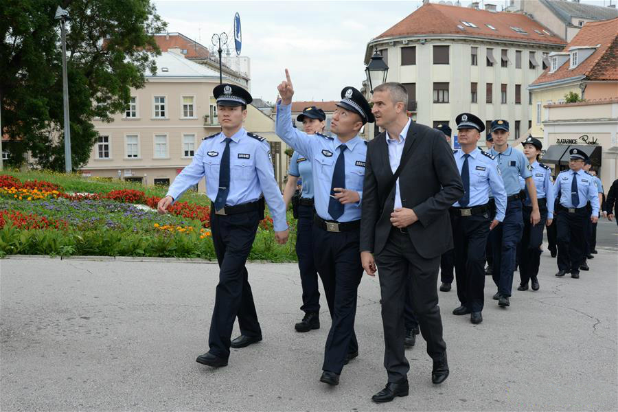 Chinese and Croatian police officers patrol after the launching ceremony of joint police patrol between China and Croatia in Zagreb, Croatia, July 13, 2019. Croatian and Chinese police officers started joint patrol for the second time here on Saturday. (Xinhua/Gao Lei)