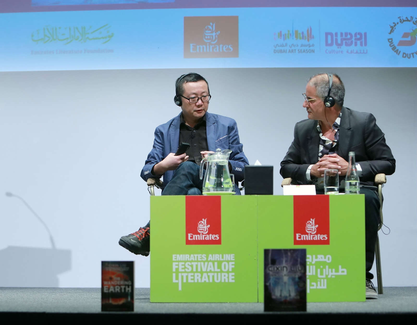 Chinese sci-fi writer Liu Cixin (L) speaks during a meeting with his readers at the Emirates Airline Festival of Literature in Dubai, the United Arab Emirates (UAE), on March 8, 2019. (Xinhua)