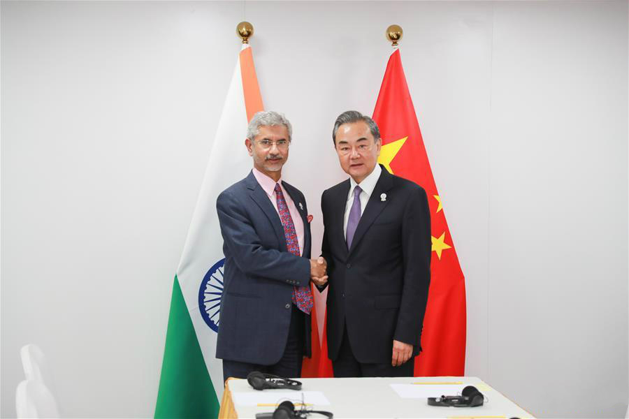 Chinese State Councilor and Foreign Minister Wang Yi (R) meets with India