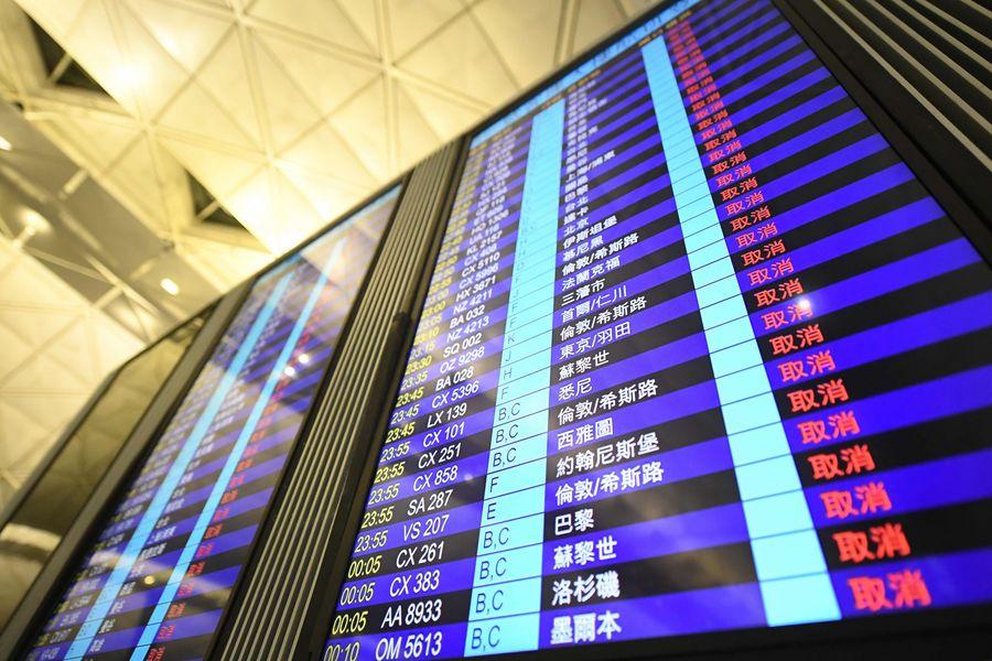 An information display board shows canceled flights at Hong Kong International Airport in Hong Kong, south China, Aug. 12, 2019. (Xinhua/Lui Siu Wai)