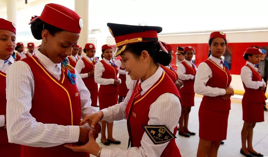 A Chinese conductor trains the Ethiopian attendants at a railway station in suburban Addis Ababa, Ethiopia, Oct. 1, 2016. The Chinese-built railway linking the Ethiopian capital and the port of Djibouti is expected to help the landlocked African country improve access to the sea and speed up a burgeoning industrialization process.